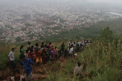 Devotees loading and unloading Mt. Arunachala.