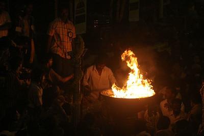 Lighting temple flame.