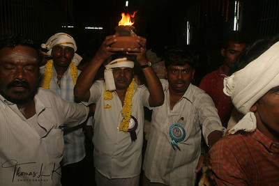 Main majhi is carries flame and others follow him with string wicks to the Mt. Arunachala.