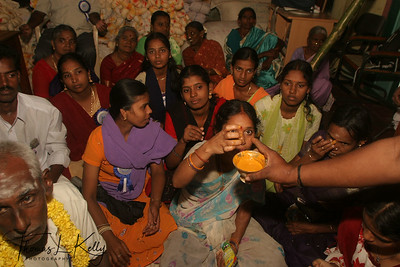 Wife of majhi being blessed with tika—yellow powder paste prior to the festival.