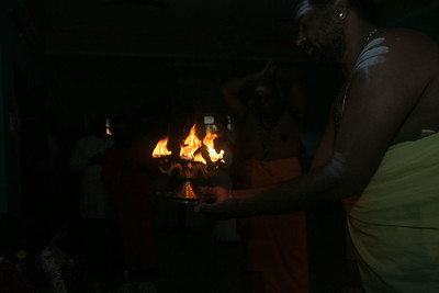 Lighting temple flame.