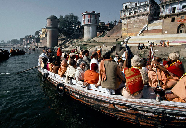 Pilgrims worshiping in the bank of Ganga river. The Ganges is the holiest river in India, and at Varanasi, it is at its holiest. Exploring the Ganges is an unforgettable experience. Varanasi, India