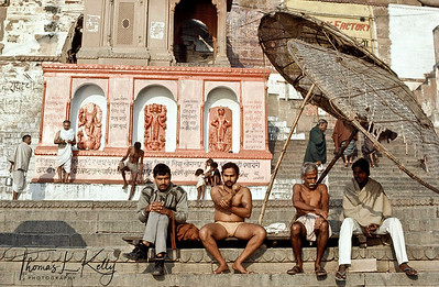 Ghat of Varanasi in the bank of Ganga river.  Much of the daily life of Varanasi revolves along the ghats of Ganges River. These is where the daily morning and evening pujas are conducted, to the ringing of bells, burning of incense and chanting. Varanasi, India