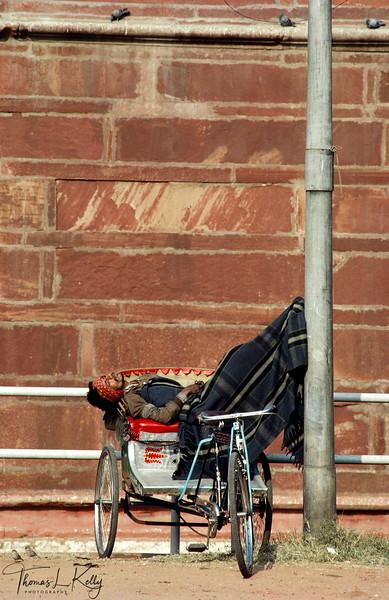 A rickshaw puller taking a mid day nap. Varanasi, India.