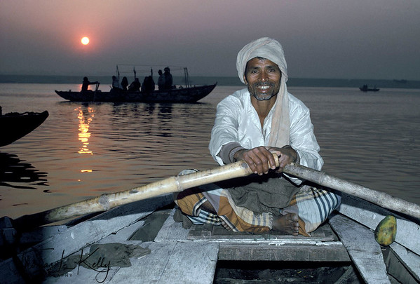 Ghat of Varanasi in the bank of Ganga river.  Much of the daily life of Varanasi revolves along the ghats of Ganges River. These is where the daily morning and evening pujas are conducted, to the ringing of bells, burning of incense and chanting. Varanasi, India.