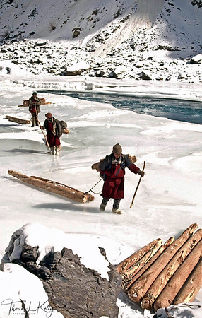 Traders aren't the only people who uses the frozen river. Those timber-getters are hauling building materials into the isolated valley-which is above the tree line.  Zanskar, India.