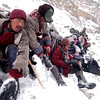 Porter slipped into the river filling their boot with freezing water. Wool socks are squeezed quickly of the water  preventing immediate frost bite.<br /> Zanskar, India