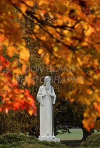 A statue of St. Benedict is framed by the fall foliage on the grounds of St. Gertrude's Monastery in Ridgely, Maryland , Wednesday, November 14, 2007. The Dialog/Don Blake