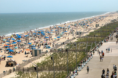Beach goers enjoy the surf and sun on Rehoboth Beach. The Dialog/Don Blake