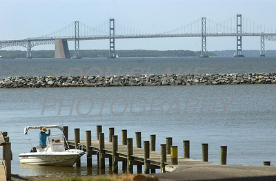 A boater secure his boat to the Matapeake Park dock with the Chesapeake Bay Bridge in the background in Stevensville, Maryland. The Dialog/Don Blake