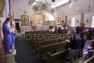 A hand full of parishioners attend mass at St. Stanislaus Kostka, Sunday, February 1, 2009. The Dialog/Don Blake