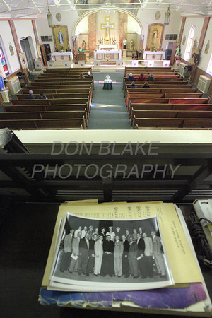 """An old photo from the church's """"Heyday"""" lay on top of the organ, in the choir loft, as a handful of parishioners attend mass at St. Stanislaus Kostka, Sunday, February 1, 2009. The Dialog/Don Blake"""