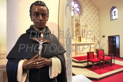 A statue St Martin De Porres sit on the left side of the alter at St. Joseph Church on French Street. The Dialog/Don Blake