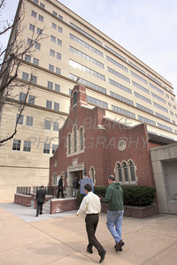 St. Joseph Church on French Street is dwarfed by the 10 story office building next door. The Dialog/Don Blake
