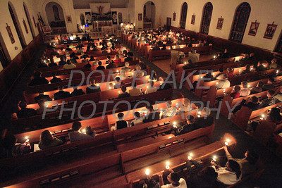 The church is a glow lit by candle light during the Easter Vigil Mass at Our Lady of Lourdes Church, Seaford, Del., Saturday, April 11, 2009. The Dialog/Don Blake