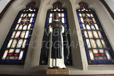 A small statue St Martin De Porres sits on the window ledge at St. Joseph Church on French Street. The Dialog/Don Blake