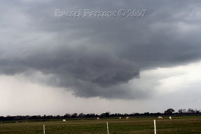 Looking West From U.S. 59 Hwy. And East 80 Road 2 miles North Of Welch, Oklahoma At A Wall Cloud