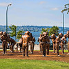 A community gathering of golden people sunning themselves. These sculptures were spotted in English Bay Park, Vancouver, BC., Canada.