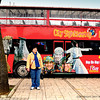 """A tourist waiting for a """"Hop-On-Hop-Off"""" bus to open it's doors. Seen at Hagia Sophia area in Istanbul, Turkey."""