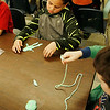 HOLLY PELCZYNSKI - BENNINGTON BANNER Monument Elementary school first grader Chase LaRoche shapes some Oobleck into a figure while listening to the Dr. Seuss book Bartholomew and the Oobleck, on Thursday March 2. Dr. Seuss's birthday.