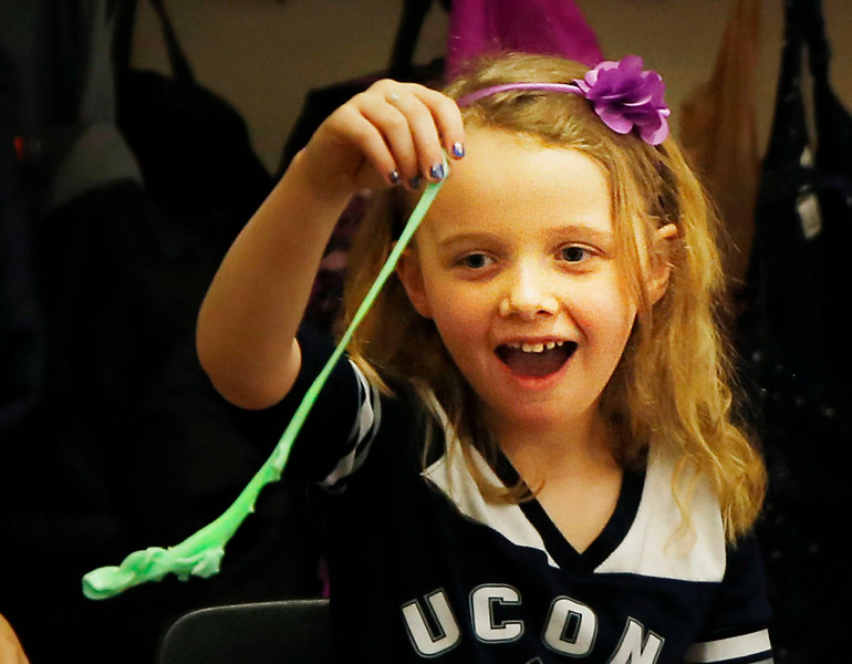 HOLLY PELCZYNSKI - BENNINGTON BANNER First grader Khiley Ferris plays with Oobleck during a special reading of Dr. Seuss's Bartholomew and the Oobleck on Dr. Seuss's birthday.