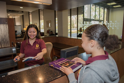 Students together in Library, studying, learning and relaxing in the beautiful South Library at California State University Dominguez Hills in August 2016