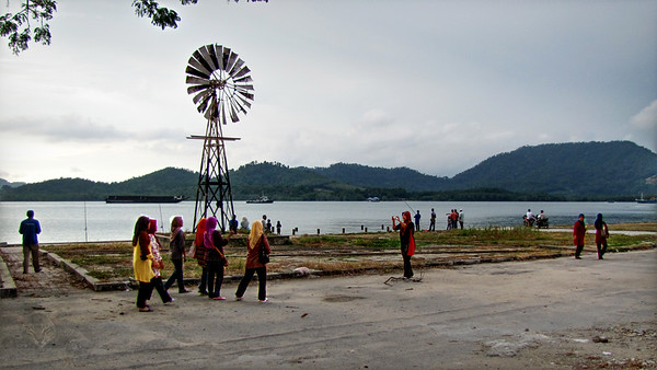 Women Walking on Lumut Waterfont