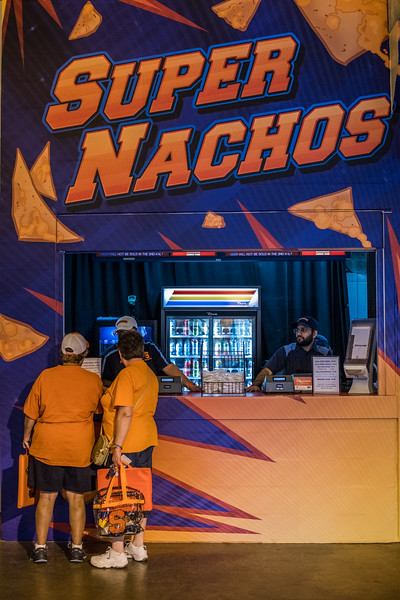 Two Syracuse fans enjoy the Carrier Dome super nachos concession stand.