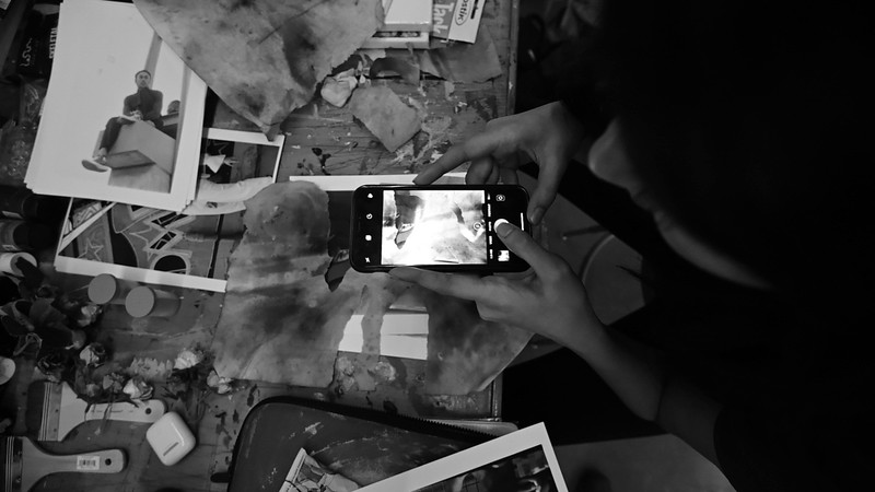 Aanya photographing her newest work.