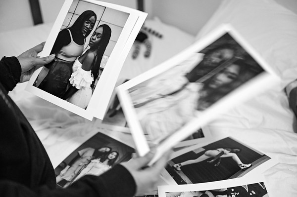 Aanya looks through her previous fashion shoot.