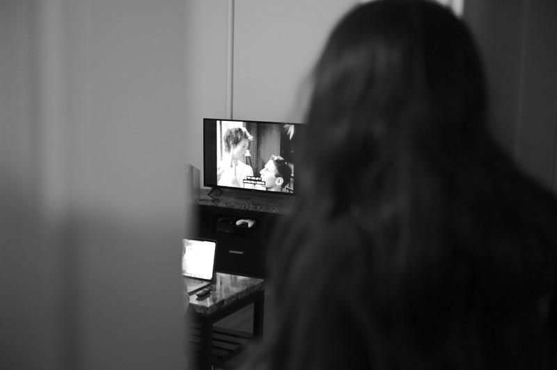 Aanya over looks her roommates watching their favorite show.