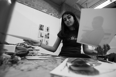 Aanya sorts through photos from her lastest shoot.
