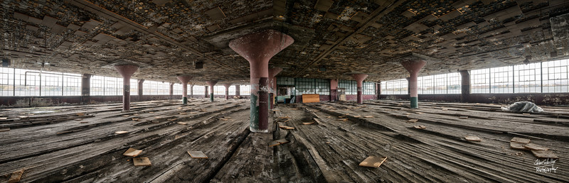 Wooden floors have buckled wildly, and ceiling tiles collapsed to the floor - all due to substantial water damage.   © John Schiller Photography