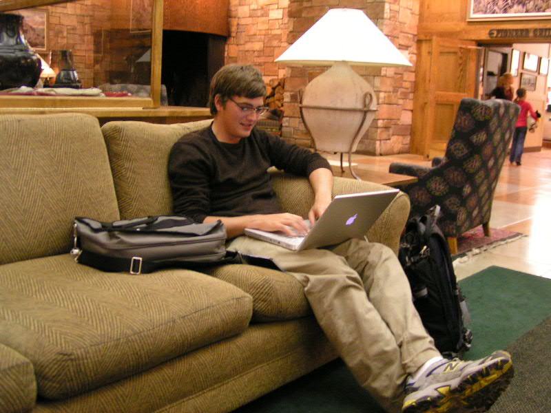 1. Zach, a wrangler from Colter Bay, does a little work on his laptop in the lobby of the Jackson Lake Lodge.