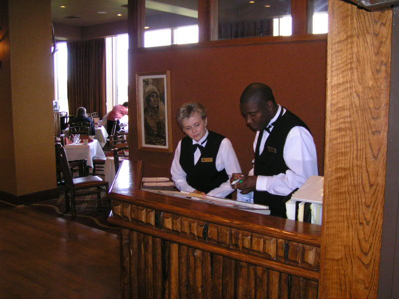 1. Pam on her first day at work as Hostess at the Mural Dining Room. Anthony from Jamaica is helping her get started.