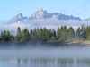 16. Fog skims the waters of Colter Bay and drapes itself around the Tetons.