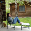14. Taking a break on the cabin porch.