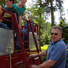 13. Ranch manager Kevin helps get them loaded before he drives them away.
