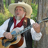 1. Gene Gardner, local gunsmith, plays a mean guitar, especially with western songs.