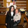 14. Hostess Angel sits on Joanna Germany's lap.