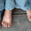 4. Blue jeans and toe nails.