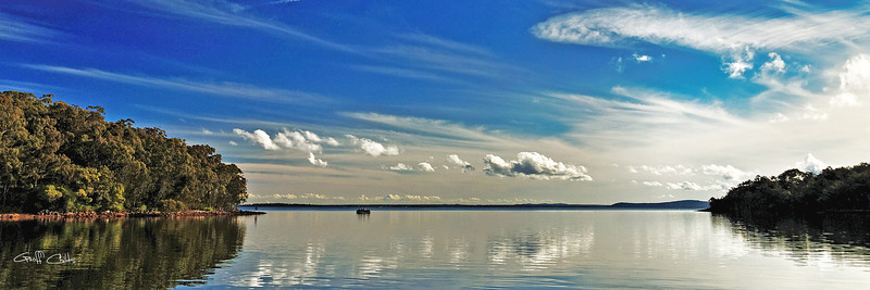 White Cumulus Cloud Reflections Landscape / seascape.