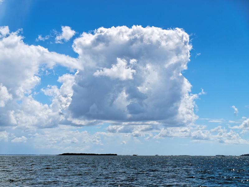 Rare Square shaped white cloud in blue sky. Australia.