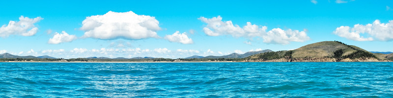 Coastal ocean sky art image. White super panorama Cumulus cloudscape in blue sky. Australia.