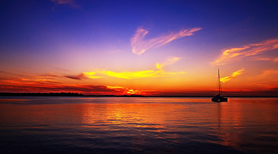 Golden coloured ciruss cloud Sunrise Seascape. Australia