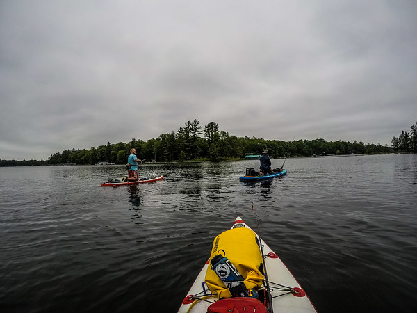 "Learning from these two ""pros"" on a lovely overcast day of SUPfishing"