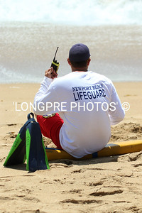 NB LIFEGUARD watching from beach.