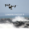 DRONE CHECKING OUT ALL THE SPECTATORS ALONG BEACH.