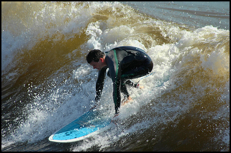 Surfing the Red Tide, shot from the oceanside Pier!  10-1-2011