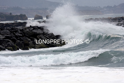 Wave breaking over NEWPORT JETTY.